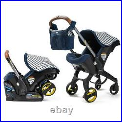 Doona car seat and stroller with BASE and Sunshade Extension and Essentials BAG